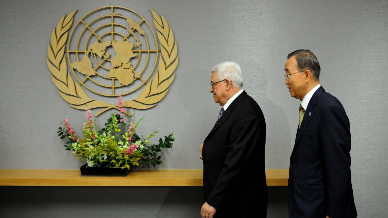 24 Sep 2011, New York State, USA --- (110923) --NEW YORK, Sept. 23, 2011 (Xinhua) -- Palestinian President Mahmud Abbas (L) enters the conference room with United Nations Secretary-General Ban Ki-moon at the United Nations headquarters in New York, the Unites States, on Sept. 23, 2011. Abbas on Friday handed the application letter to Ban in a bid to seek the UN recognition of Palestine as a full member state. (Xinhua/Shen Hong) --- Image by © Shen Hong/Xinhua Press/Corbis
