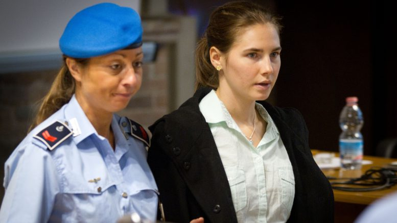 24 Sep 2011, Perugia, Italy --- Amanda come in courtroom -- Raffaele Sollecito, an Italian student, Amanda Knox, an American student and a flatmate of Kercher, were convicted of sexual assault and murder. They have now started their appeal of that conviction. 24th September 2011 --- Image by © Stefano Dottori/Demotix/Corbis