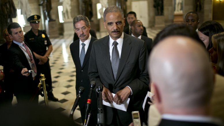 19 Jun 2012, Washington, DC, USA --- Attorney General Eric Holder speaks during a press conference after a meeting at the U.S. Capitol in Washington D.C. June 19, 2012 Benjamin Myers / Corbis --- Image by © Benjamin J. Myers/Corbis