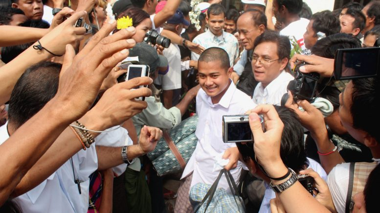 13 Jan 2012, Yangon, Burma --- (120113) -- YANGON, Jan. 13, 2012 (Xinhua) --Released prisoners walks out of the Insein jail in Yangon, Myanmar, on Jan. 13, 2012. Myanmar former Prime Minister U Khin Nyunt was among as many as over 600 prisoners being freed by the government Friday under Thursday's amnesty order endorsed by President U Thein Sein, official sources confirmed. (Xinhua/U Aung) --- Image by © U Aung/Xinhua Press/Corbis