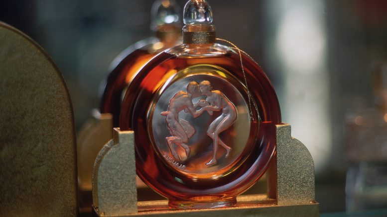 Grasse, France, France --- The Molinard Perfumerie displays an antique perfume bottle, with a picture of a satyr kissing a woman. Grasse, France. --- Image by © Gail Mooney/Corbis