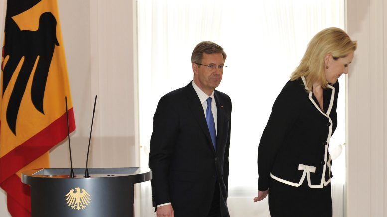 17 Feb 2012, Germany --- (120217) -- BERLIN, Feb. 17, 2012 (Xinhua) -- German President Christian Wulff (L) and his wife Bettina leave aftr Wulff makes a statement of resignation in the presidential residence in Berlin, Feb. 17, 2012. (Xinhua/Ma Ning) --- Image by © Ma Ning/xh/Xinhua Press/Corbis