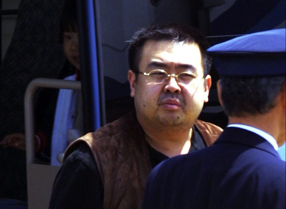 04 May 2001, Tokyo, Japan --- A man believed to be North Korean heir-apparent Kim Jong Nam is escorted by police as he boards a plane upon his deportation from Japan at Tokyo's Narita International Airport. Believed to be the eldest son of North Korean leader Kim Jong-Il, the man entered Japan with a forged passport on May 1, 2001 and is to be deported to China.© Haruyoshi Yamaguchi/Corbis