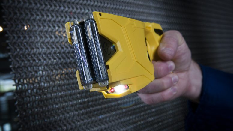 15 Dec 2014, Scottsdale, Arizona, USA --- The X2 Taser Smart Weapon is a popular non-lethal weapon law enforcement uses to subdue a suspect. The weapon deploys darts attached to a wire that remains connected to the weapon to deliver a pulsing charge to suspects that will make them lose control of muscles to allow law enforcement to subdue the suspect. They also manufacture cameras that allow police to record their activities and interactions. The cameras have grown in demand even before the recent spate of controversial police shooting --- Image by © Rick D'Elia/Corbis