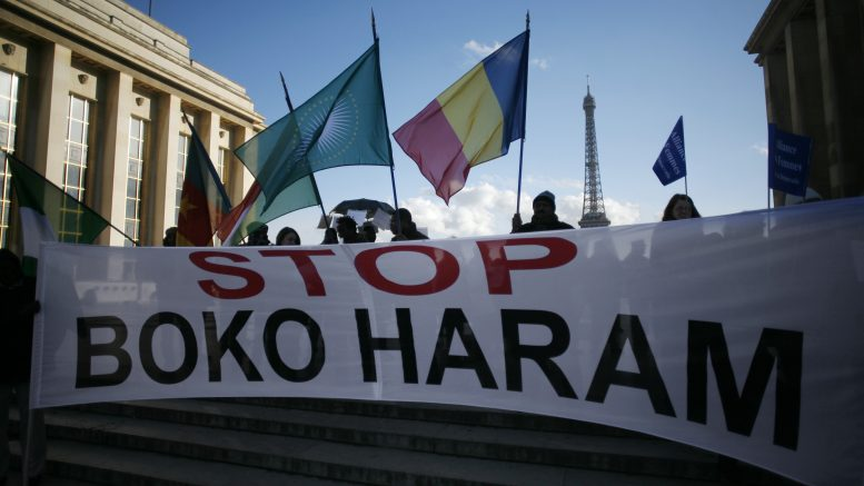 17 Jan 2015, Paris, France --- Gathering against Boko Haram attacks in Nigeria. January 17, 2015. Paris, France --- Image by © Jean Marmeisse/Corbis
