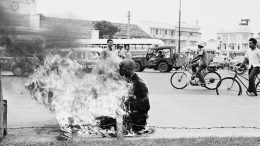 05 Oct 1963, Ho Chi Minh City, Vietnam --- As a protest against the Ngo Dinh Diem government's anti-Buddhist policies, a young Buddhist monk performs a ritual suicide, by self immolation, in the central market square of Saigon. --- Image by © Bettmann/CORBIS