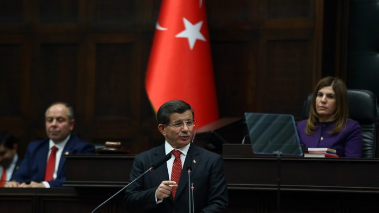 23 Dec 2015, Ankara, Turkey --- (151222) -- ANKARA, Dec. 22, 2015 (Xinhua) -- Turkish Prime Minister Ahmet Davutoglu (front) delivers a speech at the parliament in Ankara, Turkey, on Dec. 22, 2015. Turkish Prime Minister Ahmet Davutoglu said on Tuesday that Turkey's military training and equipment support for Iraq will continue until Mosul is liberated from the Islamic State (IS) militants. (Xinhua/Mustafa Kaya) --- Image by © Mustafa Kaya/Xinhua Press/Corbis