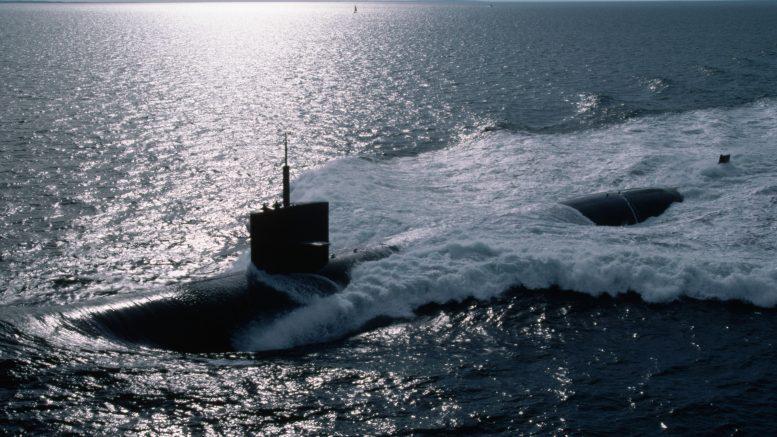 ca. 1987, Connecticut, USA --- The USS City of Corpus Christi churns the waters of Long Island Sound near Groton, Connecticut.   Location: near Groton, Connecticut, USA.  --- Image by © Steve Kaufman/CORBIS