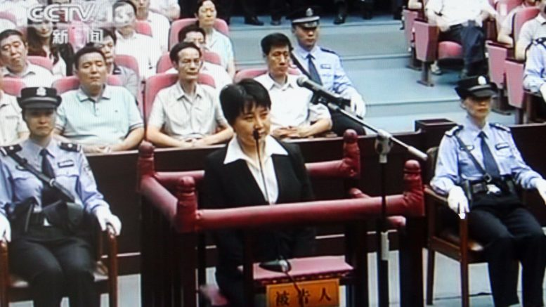 20 Aug 2012, Shanghai, China --- This TV screen shot in Shanghai shows Gu Kailai (C in black) at a Chinese court, 20 August 2012. A Chinese court sentenced Gu Kailai, the wife of Bo Xilai, to death with a two-year reprieve for intentional homicide on Monday (20 August 2012). She was deprived of political rights for life, said the court verdict announced by the Hefei City Intermediate Peoples Court in east Chinas Anhui Province. More than 100 people attended the sentencing including relatives and friends of the two defendants, diplomats from the British embassy and consulates in China, representatives from the media, deputies to Chinas legislature, members of Chinas political advisory body, as well as people from all walks of life. --- Image by © Imaginechina/Corbis