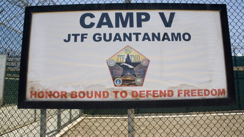 "24 May 2006, Guantanamo, Cuba --- A sign for Guantanamo Bay's Prison Camp Delta 5 reads, ""Honor Bound to Defend Freedom."" --- Image by © Cesar Vera/Latinvisions/Corbis"