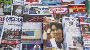 Yangon, Burma --- Myanmar,Yangon,Magazine Vendors' Display featuring Aung San Suu Kyi on Magazine Cover --- Image by © Steve Vidler/Corbis