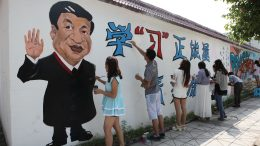 09 Jun 2015, Sichuan Province, China --- Students make final touches on cartoon graffiti featuring Chinese President Xi Jinping on a wall at Neijiang Normal University in Neijiang city, southwest China's Sichuan province, 9 June 2015. A group of students in southwest China's Sichuan province have completed their latest series of graffiti to salute Chinese President Xi Jinping. They spent more than a month painting cartoon portraits of Xi and other pictures and Chinese characters with different themes on a wall measuring over 100 meters long at Neijiang Normal University. The graffiti is said to inspire the students at the university to learn from Xi and gain positive energy from him. --- Image by © Imaginechina/Corbis