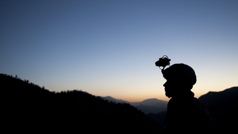 """15 May 2009, Afghanistan --- A silhouette of a US soldier during a five day mission with the 3/509 Army Airborne Geronimo Scouts in Afghanistan. The mission, known as """"Thunder"""", was to disrupt Taliban activity and find weapons caches in the south east tip of Paktika Province, 10 miles from the Pakistan Border. --- Image by © Chad Hunt/Corbis"""