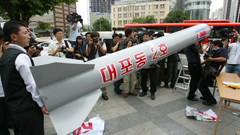 07 Jan 2016, Seoul, South Korea --- January 6, 2016 - South Korea, Seoul : Protesters carried a mock North Korean missile during a protest denouncing North Korea's missile test. North Korea said it had successfully conducted a test of a miniaturized hydrogen nuclear device on Wednesday morning, marking a significant advance in the isolated state's strike capabilities and raising alarm bells in Japan and South Korea. (Photo by Seung-il Ryu/NurPhoto) --- Image by © Seung-il Ryu/NurPhoto/Corbis