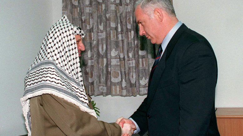 04 Sep 1996, Gaza Strip --- Yasser Arafat, President of the Palestinian National Authority, and Benjamin Netanyahu, the Israeli Prime Minister, at a summit meeting in Erez Checkpoint, between Israel and the Gaza Strip. --- Image by © Nadav Neuhaus/Sygma/Corbis