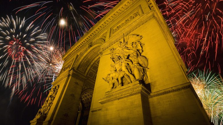 1806-1836, Paris, France --- Arc de Triomphe and Fireworks Display --- Image by © Jim Zuckerman/Corbis