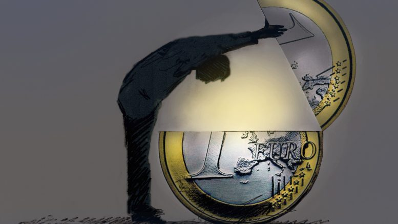 Man looking inside large Euro coin --- Image by © Gary Waters/Ikon Images/Corbis