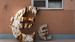 Rusty metal euro symbols leaning against a wall --- Image by © Martin Dr. Baumgärtner/imageBROKER/Corbis