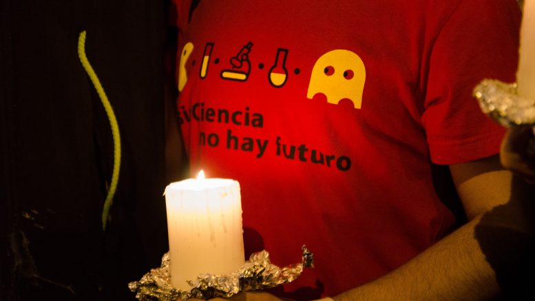 27 Sep 2013, Madrid, Spain --- Madrid, Spain. 27th September 2013 -- Detail of the t-shirt of one of the mourners againt science cuts. He is holding a candle. -- Thousands of scientists protested against cuts on the science budget under the motto There is no future without science. The demonstration was held during Science Night in Madrid. --- Image by © Valentin Sama-Rojo/Demotix/Corbis