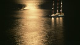 August 2005, Croatia --- Ship Afloat by Moonlight --- Image by © Rudy Sulgan/Corbis