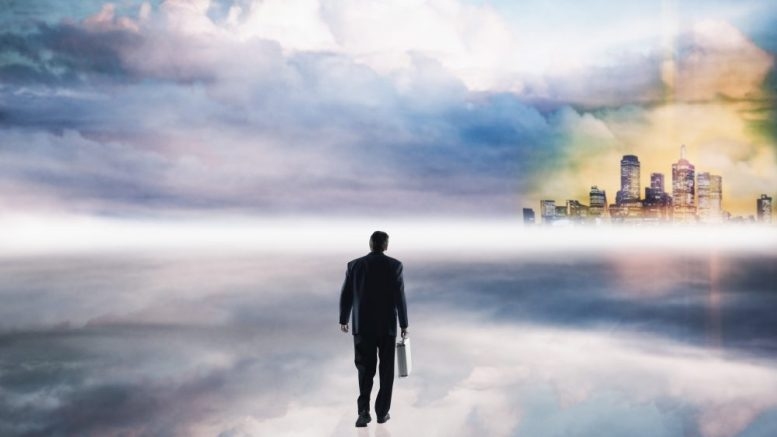 Man Walking in the Clouds --- Image by © Corbis