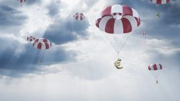 Parachutes with euro sign falling from sky --- Image by © Viaframe/Corbis
