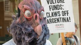 09 Jul 2014, London, England, UK --- London, United Kingdom. 9th July 2014 -- Vulture mask and placard at Jubilee Debt Campaign protest in solidarity on Argentinian Independence day at vulture fund Elliot Associates urges Argentina not to make debt repayments to wealthy speculators. -- The future of Argentina lies in the balance following a US court decision that it must pay .3 bn to US vulture funds who bought up its debts cheaply. Protesters in London on Argentinian Independence Day urged it to refuse to pay. --- Image by © Peter Marshall/Demotix/Corbis