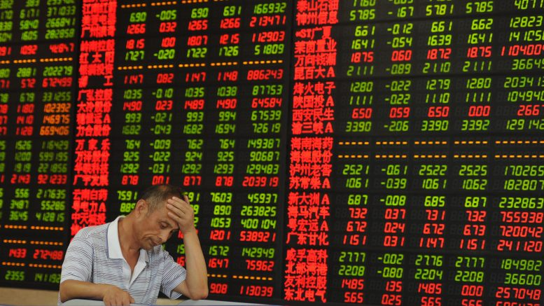 05 Aug 2015, Fuyang, Anhui Province, China --- A concerned Chinese investor is pictured in front of a screen displaying prices of shares (red for price rising and green for price falling) at a stock brokerage house in Fuyang city, east China's Anhui province, 5 August 2015. China's stocks dropped for the fourth time on Wednesday (5 August 2015) in five days as turnover waned and concern grew that government intervention is driving away investors. The benchmark Shanghai Composite slid 1.65 percent to 3694.57 at the close. after gaining as much as 0.7 percent. Volume was 31 percent below the 30-day average for the time of day. Technology and phone stocks led declines, with Leshi Internet Information & Technology (Beijing) Co. and ZTE Corp. losing more than 2 percent. The value of shares traded on the index has fallen 65 percent from this year's high in June as trading halts, regulatory measures to curb bearish --- Image by © Imaginechina/Corbis