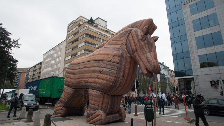 15 Oct 2015, Brussels, Belgium --- Brussels, Belgium. 15th October 2015 -- A giant inflatable Trojan horse seen in Schuman Square during a protest against the Transatlantic Trade and Investment Partnership, a series of trade negotiations being carried out mostly in secret between the EU and US. -- More than 500 activists blocked the access points to Schuman Square in Brussels where a European summit was taking place, to protest against the Transatlantic Trade and Investment Partnership (TTIP). --- Image by © Frederik Sadones/Demotix/Corbis