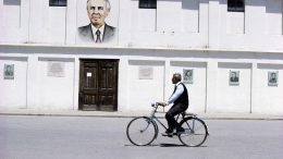 1980s, Berat, Albania --- Enver Hoxha Portrait on Building --- Image by © Michel Setboun/Corbis