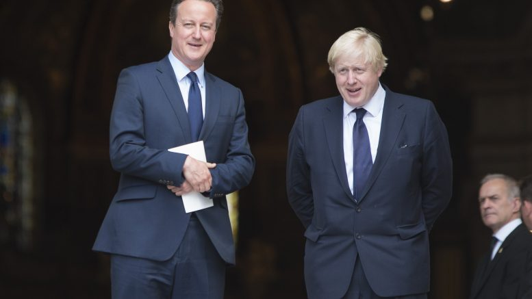 07 Jul 2015, London, England, UK --- London, United Kingdom. 7th July 2015 -- David Cameron and Boris Johnson attend memorial service of 7/7 attacks at St Paul's Cathedral in London, UK. -- Marking the 10th anniversary of the 2005 London bombings, British Prime Minister David Cameron and Mayor of London and Member of Parliament Boris Johnson attend a remembrance service for the victims at the St Paul's Cathedral in London. --- Image by © Ik Aldama/Demotix/Corbis
