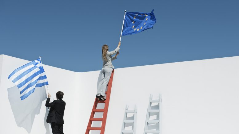19 Dec 2011 --- Executives climbing ladders, holding European Union flag and Greek flag to symbolize economic crisis --- Image by © Milena Boniek/PhotoAlto/Corbis