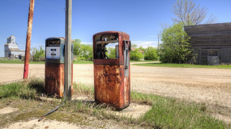 27 May 2014, Saskatchewan, Canada --- A derelict gas station in a town on the Canada-US border. --- Image by © Pete Ryan/Ocean/Corbis
