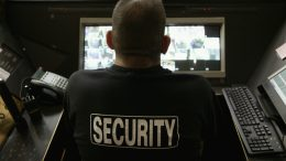 Security Guard Monitoring Video --- Image by © Bill Varie/CORBIS