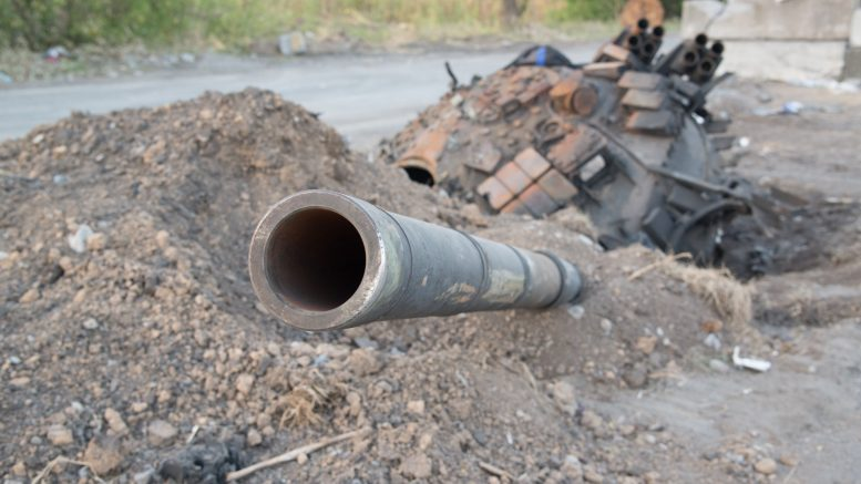 Sep 2014, Donetsk, Donets Basin, Eastern Ukraine, Ukraine --- Donetsk, Ukraine. 2nd September 2014 -- The half-buried turret of a Ukrainian T-80 tank destroyed the previous day by Donetsk People's Republic forces lies in the middle of the H20 road outside the town of Olenivka, near Donetsk. -- Heavy armed vehicles of Russian origin flying the Novorossiya flag seen on the outskirts of Donetsk; a destroyed T-72 main battle tank belonging to Ukrainian forces; and tank track marks seen in roads in the centre of Donetsk. © Maximilian Clarke/Demotix/Corbis