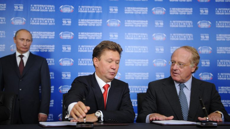 18 Sep 2011, Sochi, Russia --- ITAR-TASS: SOCHI, RUSSIA. SEPTEMBER 16, 2011. Prime Minister Vladimir Putin, Gazprom CEO Alexei Miller, and Chief executive officer of Italian ENI Paolo Scaroni (L-R) signing South Stream Transport shareholders' agreement on offshore section of the South Stream project. (Photo ITAR-TASS / Alexandra Mudrats) --- Image by © Mudrats Alexandra/ITAR-TASS Photo/Corbis