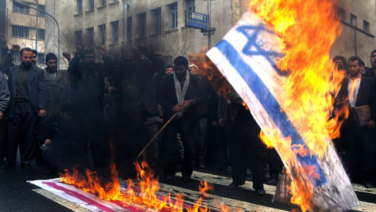 Tehran, Iran --- Burning the US and Israeli flags. --- Image by © Kami/arabianEye/Corbis